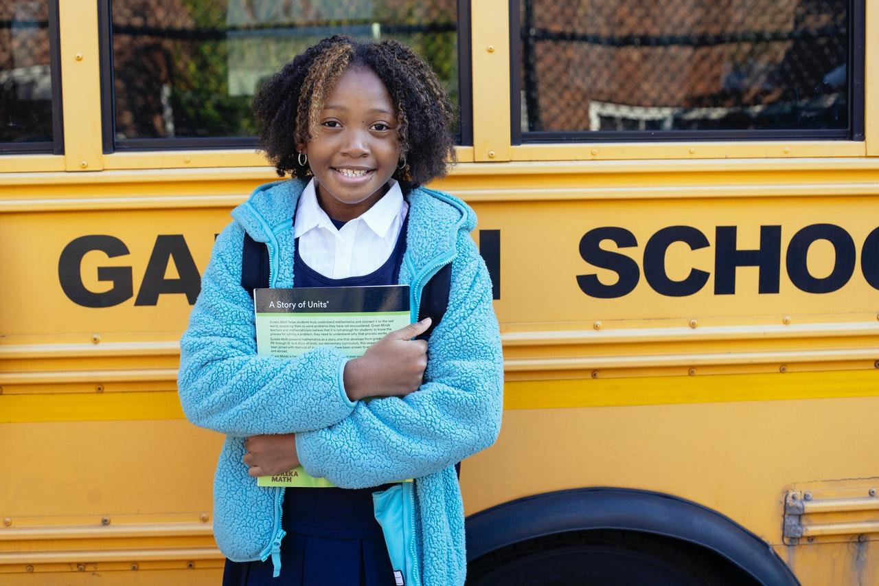 Schoolgirl in front of bus